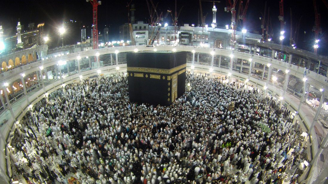 Muslims circle the Kaaba and pray during Umrah, as construction cranes are seen at the Grand Mosque, in the holy city of Mecca January 10, 2014