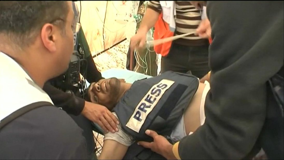 Photographer Yasser Murtaja was speaking to paramedics as he was taken to hospital but died