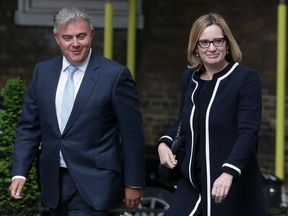 Britain's Minister of State for Immigration Brandon Lewis (L) and Britain's Home Secretary Amber Rudd arrive to attend a Cabinet meeting at 10 Downing Street in central London on June 12, 2017, following the June 8 snap general election in which the ruling Conservatives lost their majority.