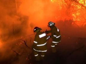 Firefighters tackle the flames on the outskirts of Sydney