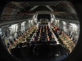 British troops and service personnel prepare to travel to Camp Bastion in Afghanistan on an RAF C17 aircraft from Oman