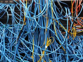 In this photo illustration, network cables are plugged in a server room on November 10, 2014 in New York City. U.S. President Barack Obama called on the Federal Communications Commission to implement a strict policy of net neutrality and to oppose content providers in restricting bandwith to customers