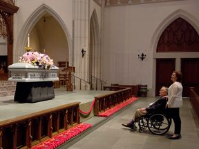 "Former President George H. W. Bush looks at the casket with his daughter Dorothy ""Doro"" Bush Koch"