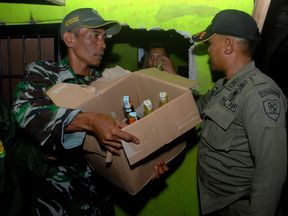 Illegal alcohol being removed from a house in West Java earlier this month