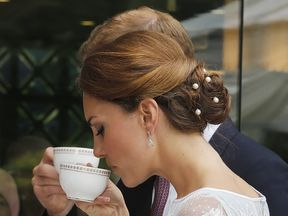 The Duke and Duchess of Cambridge drink tea during a Diamond Jubilee Tea Party at the British High Commission in Kuala Lumpur, as part of a nine-day tour of the Far East and South Pacific, in honour of the Queen's Diamond Jubilee. PRESS ASSOCIATION Photo. Picture date: Friday September 14, 2012. See PA story ROYAL Jubilee. Photo credit should read: Danny Lawson/PA Wire