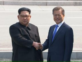 The two leaders meet in the demilitarised zone