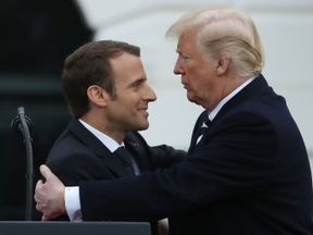 Mr Macron and Mr Trump during the welcome ceremony