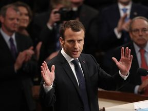 Mr Macron's speech was punctuated by repeated standing ovations and loud applause