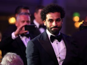 Liverpool's Mohamed Salah collects his PFA Player Of The Year Award during the 2018 PFA Awards at the Grosvenor House Hotel, London. PRESS ASSOCIATION Photo. Picture date: Sunday April 22, 2018. See PA story SOCCER PFA. Photo credit should read: Steven Paston/PA Wire