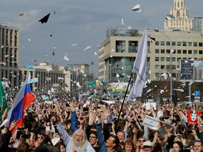 People release paper planes, symbol of the Telegram messenger,  in protest against a decision to block the messenger because it violated Russian regulations, in Moscow
