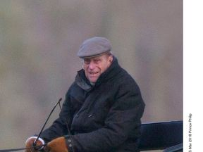 Prince Philip pictured driving a horse-drawn carriage in Windsor in March