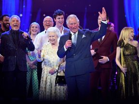 The Queen and Prince Charles join the stars on stage