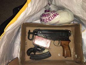 A Scorpion sub-machine gun was recovered in the raid