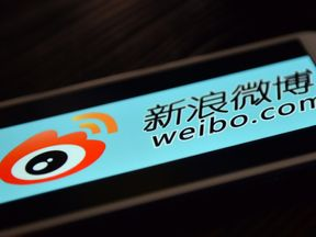 This photo illustration taken on March 19, 2014 shows the logo of Chinese microblogging platform Weibo on a smartphone in the Chinese financial city of Shanghai
