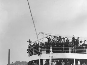 22nd June 1948: The ex-troopship 'Empire Windrush' arriving at Tilbury Docks from Jamaica, with 482 Jamaicans on board, emigrating to Britain