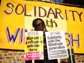 People attend an event in Windrush Square, Brixton, south London