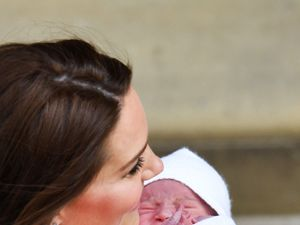 William and Kate show new prince to the world