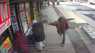 CCTV shows the man pointing the pipe on the street