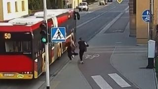 Near miss as girl barges friend in front of bus