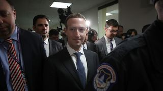 WASHINGTON, DC - APRIL 09: Facebook CEO Mark Zuckerberg (C) leaves the office of Sen. Dianne Feinstein (D-CA) after meeting with Feinstein on Capitol Hill on April 9, 2018 in Washington, DC. Zuckerberg is meeting with individual senators in advance of tomorrow's scheduled hearing before the Senate Judiciary and Commerce committeees. (Photo by Win McNamee/Getty Images)