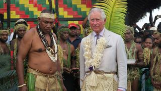 Prince Charles stands with Chief Seni Mao Tirsupe, the President of the Malvatumauri Council of Chiefs, at the Chiefs Nakamal in Port Vila, Vanuatu