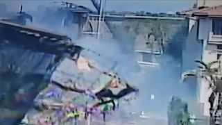 Scaffolding collapses on burning building site in US
