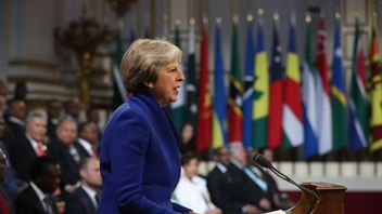 Britain's Prime Minister Theresa May speaks at the formal opening of the Commonwealth Heads of Government Meeting (CHOGM) at Buckingham Palace in London on April 19, 2018. - Queen Elizabeth II, the Head of the Commonwealth opened the Commonwealth summit for what may be the last time today. (Photo by Jonathan Brady / POOL / AFP) (Photo credit should read JONATHAN BRADY/AFP/Getty Images)
