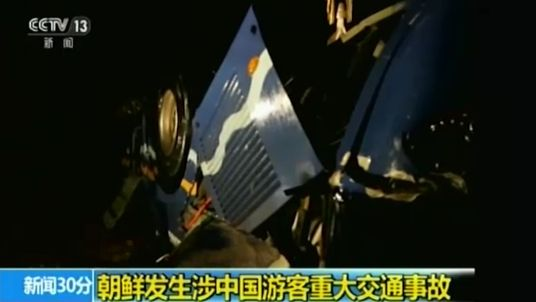 Footage on state television showed the bus with its wheels in the air