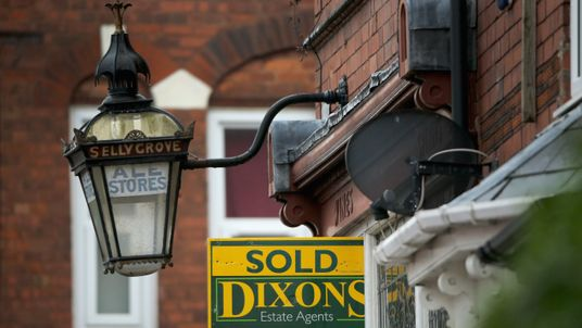 An array of For Sale signs protrude from houses in the Selly Oak area of Birmingham