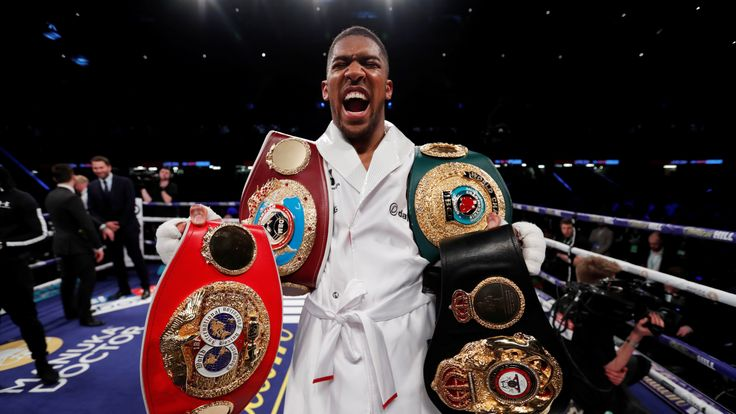Anthony Joshua vs Joseph Parker - World Heavyweight Title Unification Fight - Principality Stadium, Cardiff, Britain - March 31, 2018 Anthony Joshua celebrates with the belts after winning the fight