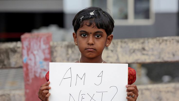 A girl holds a placard during a protest against the rape of an eight-year-old girl in Kathua, near Jammu, in Kochi, India April 15, 2018
