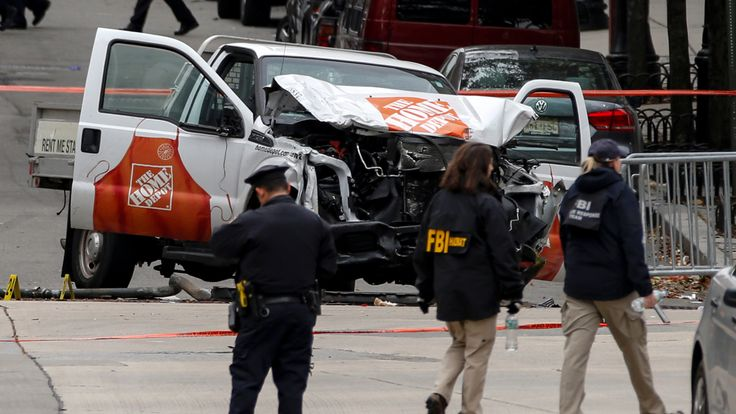 FBI agents and New York City Police Department (NYPD) investigate a pickup truck used in an attack on the West Side Highway in lower Manhattan