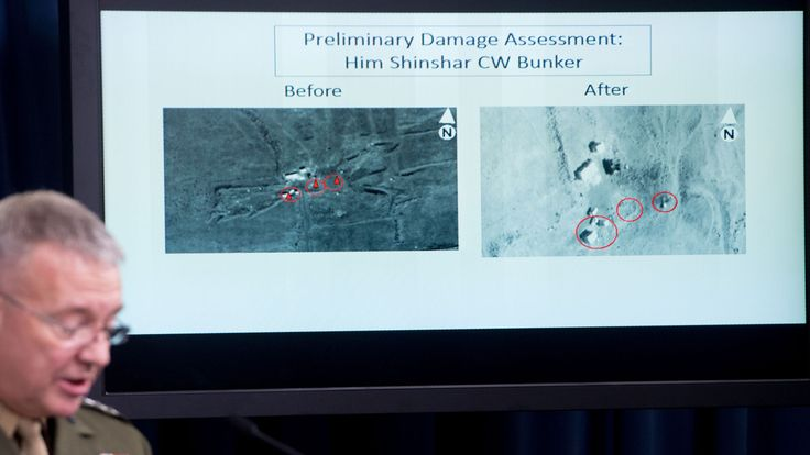 Director, Joint Staff, US Marine Lt. Gen. Kenneth F. McKenzie Jr., shows a damage assesment image of the Him Shinshar Chemical bunker site as he briefs the press on the stikes against Syria, at the Pentagon in Washington, DC, on April 14. 2018