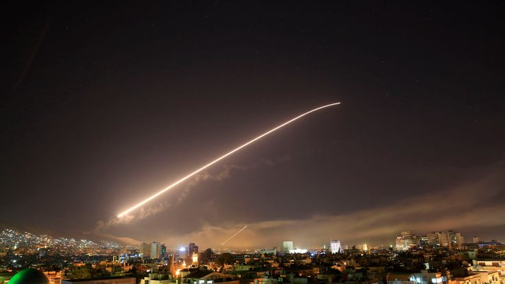 The Damascus sky lights up with surface-to-air missile fire