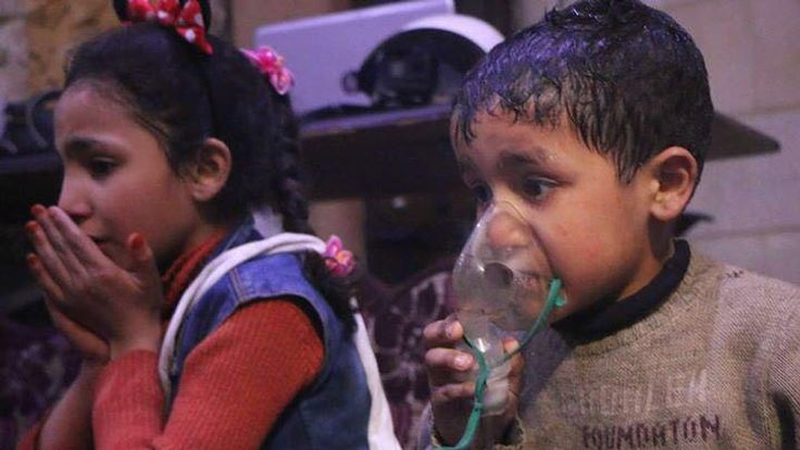 Children suffering the effects of a suspected gas attack in Douma. Pic: UOSSM