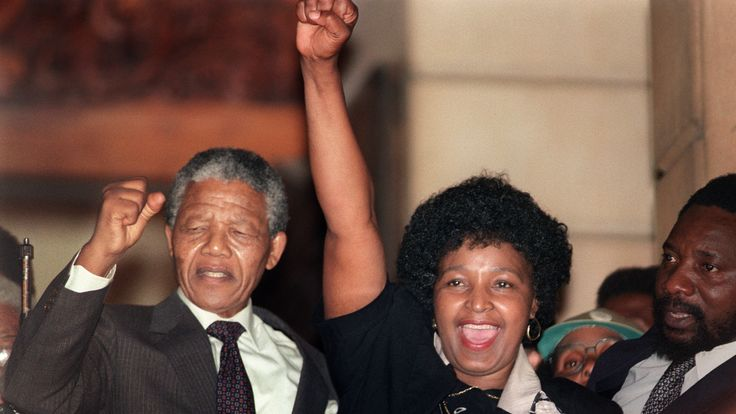 Anti-apartheid leader and African National Congress (ANC) member Nelson Mandela (L) and his then-wife Winnie raise their fists 11 February 1990 in Paarl to salute cheering crowd upon Mandela's release from Victor Verster prison. (Photo credit should read WALTER DHLADHLA/AFP/Getty Images)