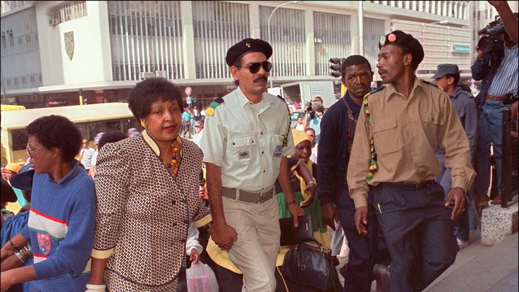 Winnie Mandela (L) arrives at court in Johannesburg, in 1991, for her trial where she is facing charges of kidnapping and assault