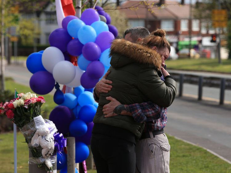 Two people hug as they visit Alder Hey Hospital in Liverpool after Alfie Evans' death