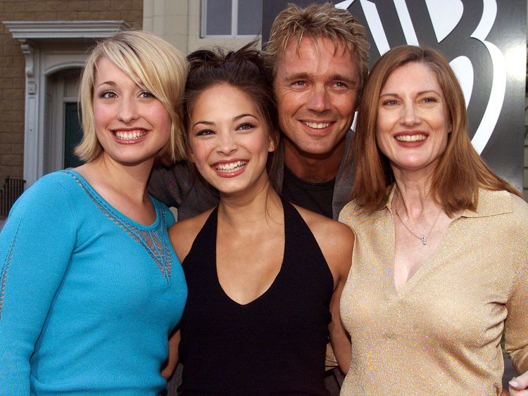 Mack (left) with co-stars Kristin Kreuk, John Scheneider and Annette O'Toole at a 2001 launch party for Smallville
