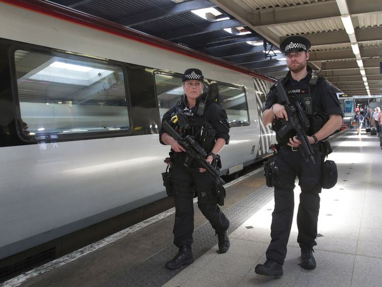 Armed police patrol transport hubs in London