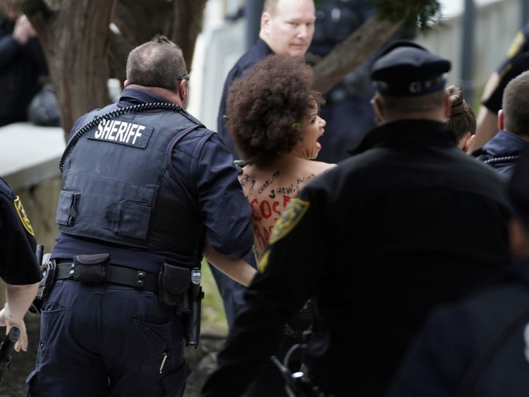 Topless protester targets Bill Cosby at retrial