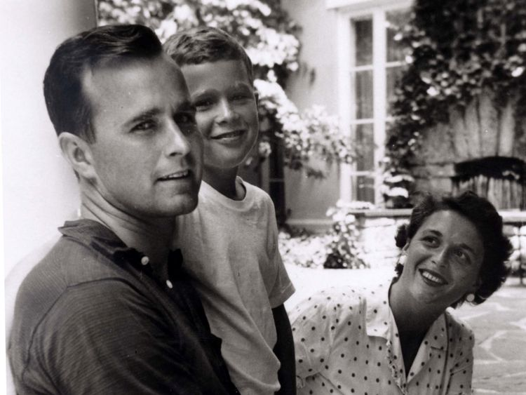 George W. Bush is shown with his father, future President George Bush and mother, future first lady Barbara Bush in Rye, New York, in this file photo taken during the summer of 1955