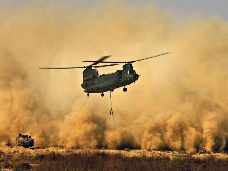 Undated handout photo issued by The Ministry of Defence of a Royal Air Force CH47 Chinook Helicopter creating a dust storm during the re-supply of the men of 42 Commando Royal Marines at Patrol Base Delhi