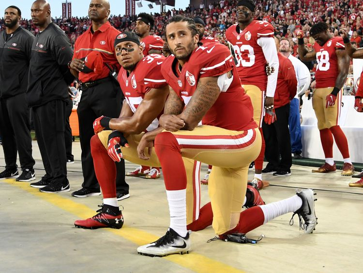 Colin Kaepernick (front) with teammate Eric Reid kneeling in protest in September 2016
