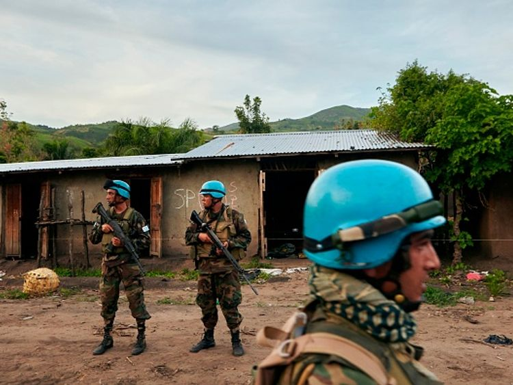 UN soldiers patrol the area surrounding the village of Kafe