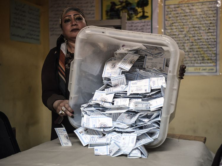 TOPSHOT - Electoral workers sort ballots to be counted at the end of the final day of the Egyptian presidential election in Cairo, Egypt, 28 March 2018