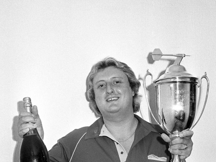 Eric Bristow with his world championship trophy in 1984