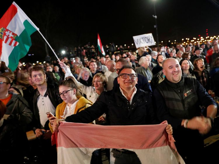 Supporters of Fidesz party react after the announcement of the preliminary results of parliamentary election in Budapest, Hungary, April 8, 2018