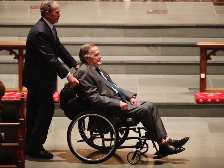 Former President George H.W. Bush, assisted by his son former President George W. Bush enter the churcj during the funeral for former First Lady Barbara Bush at St. Martin...s Episcopal Church on Saturday, April 21, 2018, in Houston. ( Brett Coomer / Houston Chronicle / POOL )