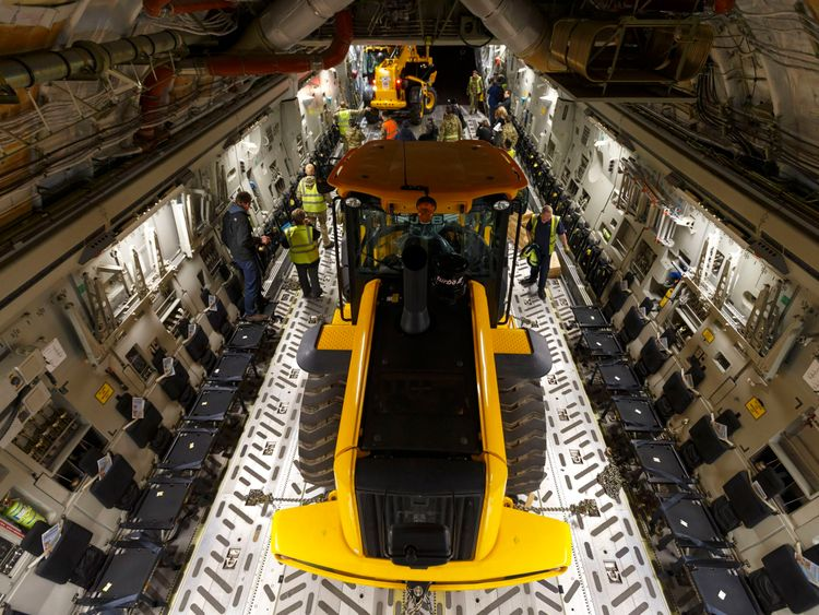 RAF ground crew load emergency supplies including JCB diggers and Land Rovers to an RAF C-17 transport plane at Brize Norton in Oxfordshire before heading to Cebu in the Philippines to help aid the relief effort following the devastation caused by Typhoon Haiyan. 2013